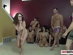 Large group of people play a naughty game of Strip