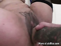 Her tattooed pussy takes a brutal fist fucking