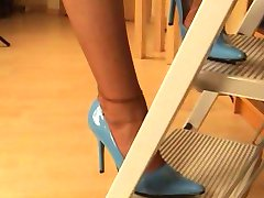 Naughty blond librarian in silk stockings and heels teasing