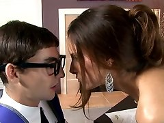 Big-chested raven haired sweetie blows smelly manhood of her young teacher greedily