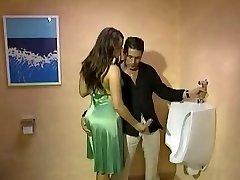 Fully Dressed Handjob in toilette