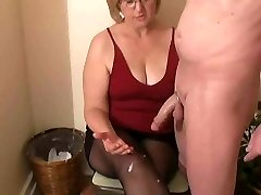 Mrs. Watson gives her neighbour a hand-job