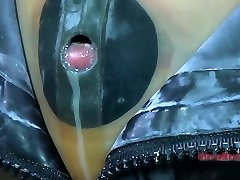 Taut black rubber mask makes Kristine Andrews suffocate and sob