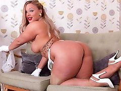 Big tits blonde strips in retro undergarments strokes in high heels