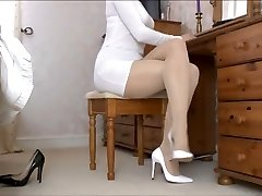 Lady Tan Stocking legs and white shoes .
