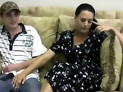Handjob is given by sexy mom