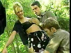 two italian police officers tearing up a prisoner in outdoor