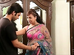 Indian tutor in sexy pink hooter-sling and sari seducing young guy