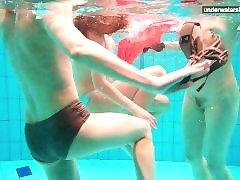 3 nude girls have fun in the water