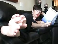 Mature lady on the couch, showing off her sexy soles :D