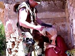 An Arab woman receives a punishment by a soldier