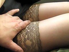 Groping her legs in tan stockings in a bus