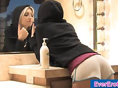 Blonde rubs herself slowly with body lotion