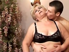 Slim Light-haired 50+ with young man in bed