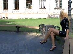 beautiful blonde woman walking in the park