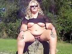 Fat light-haired chick pissing