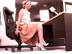 Mature long legged blonde spreads her pretty cootchie at work
