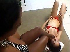 Black girl makes white girl lick her feet