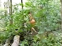 Cutie clothed as an indian sucks ding-cumbot in the woods