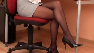 Sexy assistant in black pantyhose