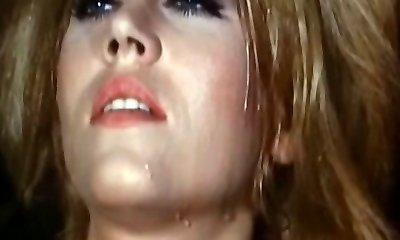 Blonde reaches orgasm in a weird retro porn vid