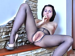 Doll-faced cutie masturbates with a dildo boasting her smooth nyloned feet