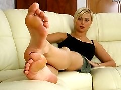 Kinky blonde mistress in search of new slaves shows her feet and dirty shoes that need to be cleaned by licking