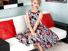 In a full skirted frock, brown fully fashioned nylons and red patent leather sling backs Chloe looks a doll!
