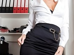 Secretary Natascha playing with herself in black hold ups and lacy thong!