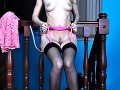 Wanton naked teaser stretches her black stockings before donning them on