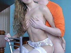 White-stockinged gal shows her bare ass cheeks for quick anal on a barstool