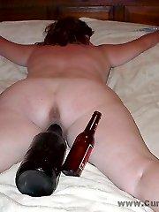 Chubby wife slut takes a big BOTTLE
