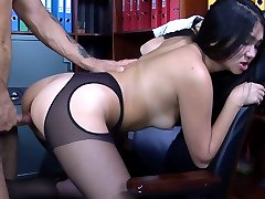 Slutty Asian secretary in black suspender tights servicing her studly boss