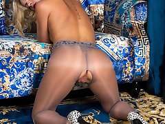 Luscious blonde Vanessa gets horny in a special pair of pantyhose, glossy grey with a pretty lace waist band and crotch-less too!