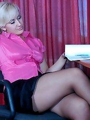 Fiery business lady takes a break shoving a dildo under pantyhose waistband