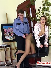 Hot mature babe in shiny tan pantyhose making spread-eagle for mighty cock