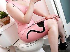 Big breasted tattooed cutie in pink rubber dress