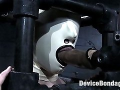 Swiss visits Device Bondage and gets put through several punishing experiences while locked up in metal devices. Clamped into a rigid iron wrist and ankle spreader, the tender flesh of her inner thighs is vulnerable and exposed to be worked over with painful clips and clamps connected together to eventually be ripped off together as a zipper. Her cunt and asshole are electrified, eliciting delicious screams and moans before she is subjected to an intense humiliation scene, her senses deprived with a latex hood and she is controlled and made to waddle around like a blind animal, mouth stuffed with rubber cock as she is paddled and spanked.