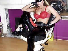StraOn Jane straps her slave to her bondage wheel and humiliates him