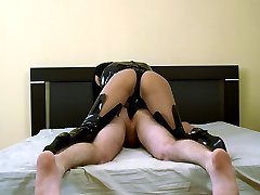 Femdom mistress makes a girlie plow her boyfriends butthole with strap-on