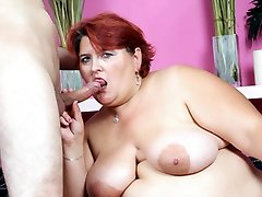 Chubby redhead Hilda gives her stud a sexy oral and later got her juicy snatch pounded in this...