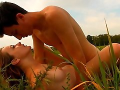 In the field, this cute brunette cant wait to unbutton her dress and have her tender body...