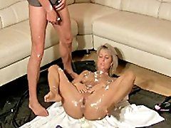 Hot blonde babe gets fisted and covered in piss