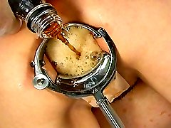Extreme speculum stretched gaping anus with cola enema