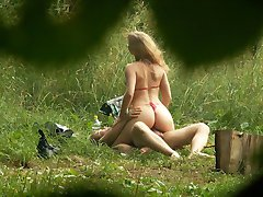 Spy cam films a story of hot love on a beach meadow