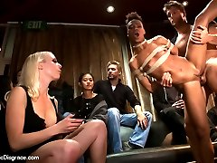 Tight bodied, Nikki Darling, is bound and gagged, fucked, footed, and fisted on stage in a divey bay area bar. Lorelei Lee parades her sex toy around for the crowd not only to see, but to touch, and to rip off all her clothes! Lorelei and Ramone cane and flog her as random people spank her on stage. Clamps are applied and Nikki begs for more whilst adorning a collar, bound forearms and biceps, as well as a leash made of rope.  Ramone is waiting to shove his giant cock into all of Nikki\'s holes, but not before she is hoisted onto the bar and videotaped while being fisted. But, fisting is just a warm up for Nikki, She then bends backward over the bar and deep throats Ramone\'s huge wanting cock. Her pussy is plowed on top of the bar and then taken over to a booth where she buries her face down/ass up into the crotches of the bar patrons!! Ramone gives it to her like a PRO while Lorelei Lee continues her sadistic humiliation with the flogger and cane.