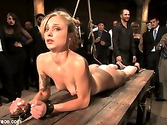 Catrina Cummings has never tried BDSM before. She is a total novice. She gets tied down and stripped by a group of 50 people who use her for their amusement. She gets fingered in the ass while bound then pulled into agonizing bondage with an ass hook attached to her hair. She is locked in metal fetters and made to service multiple cocks while bound and helpless. She is caned and flogged. She is fucked by multiple men. When she doesn\'t perform as desired she is humiliated watching Bella Rossi get all the dick and all the pleasure. In the end she pulls through and is ready for more.