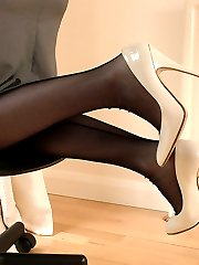 Sexy blonde Secretary Toni shows you around her home office in a pair of black nylons and cream...