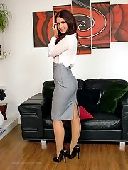 Hot brunette Carla shows off her gorgeous seamed nylons and shiny stilettos around the house,...