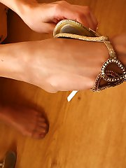 Spicy chick puts to work her hands while stroking her feet in tan pantyhose